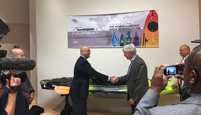 KLO/GSC CEO Chuck Smith greets Michigan Gov. Rick Snyder as the company announces its $9.2 million corporate HQ and manufacturing expansion, job creatin in Muskegon.